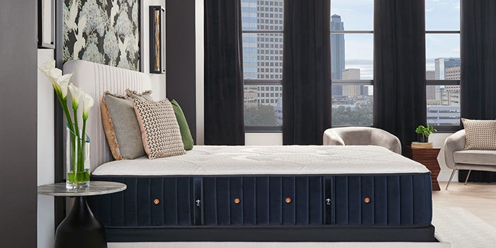 Stearns & Foster mattress in a room with a city view
