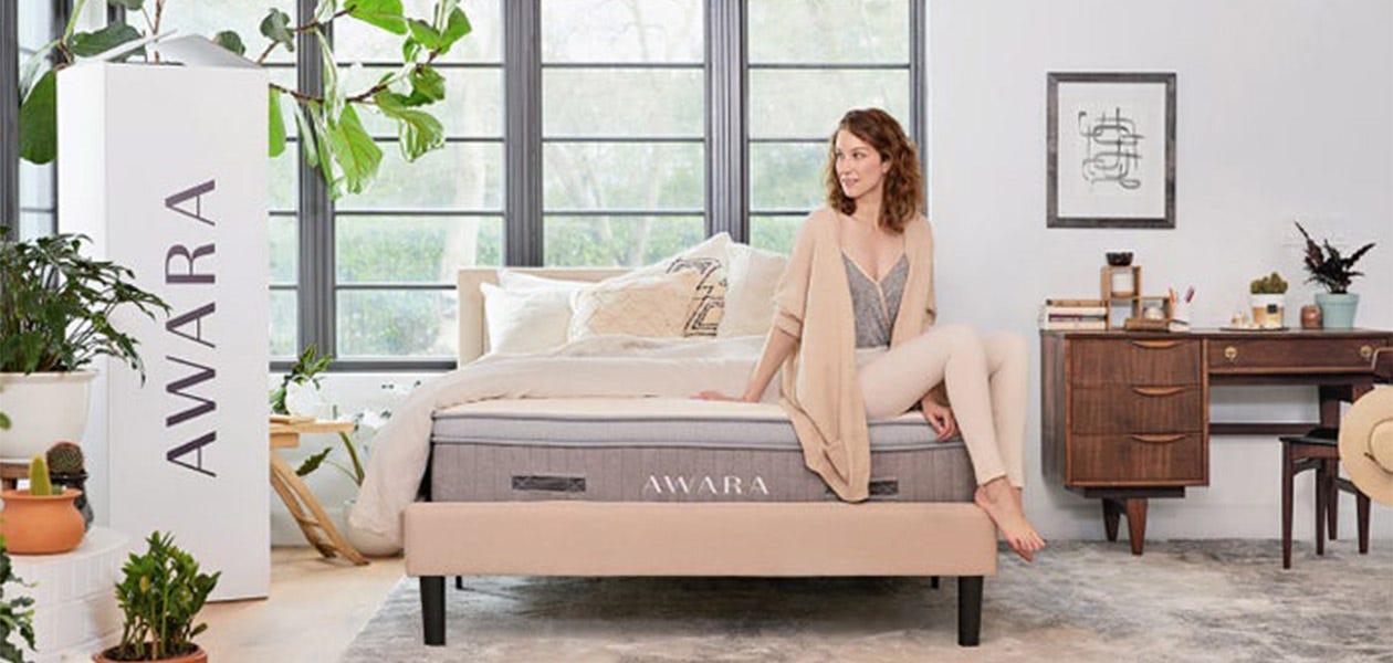 Woman sitting on an Awara mattress