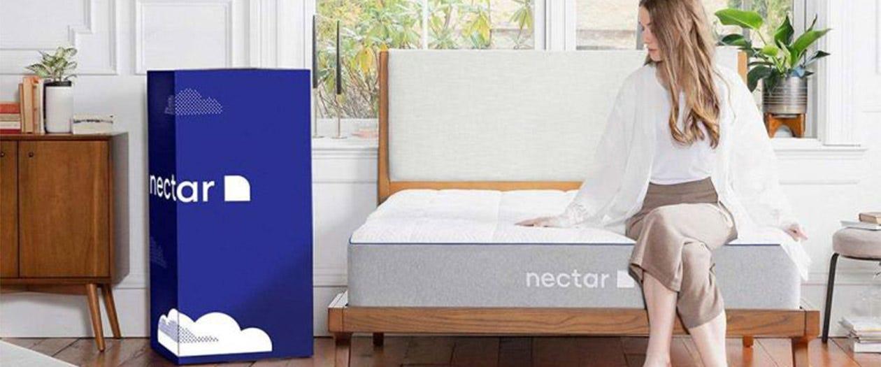 Woman sitting on a Nectar mattress