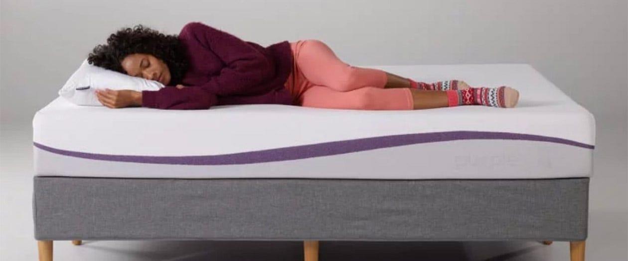 Woman laying on a Purple mattress