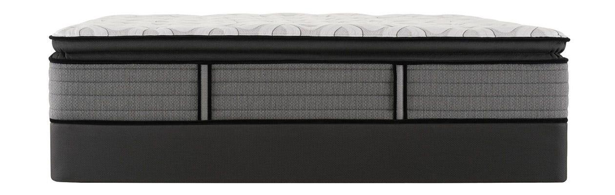 Sealy Response Cooper Mountain IV Plush Pillow Top mattress on top of a box spring