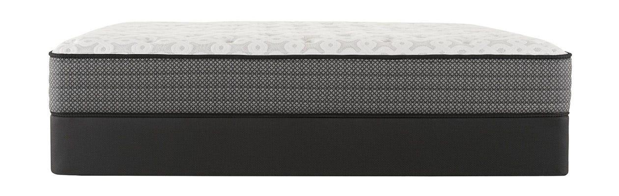 Sealy Response Santa Paula IV Cushion Firm mattress on top of a box spring