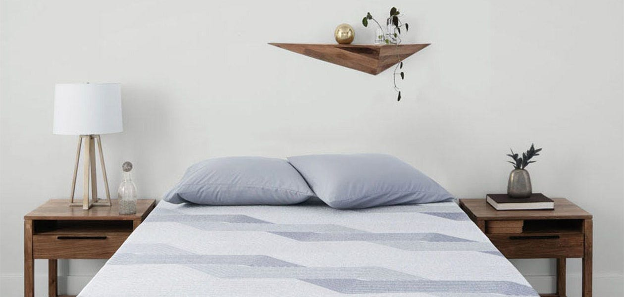 Serta iComfort Blue 300 CT Firm lifestyle - mattress in a room