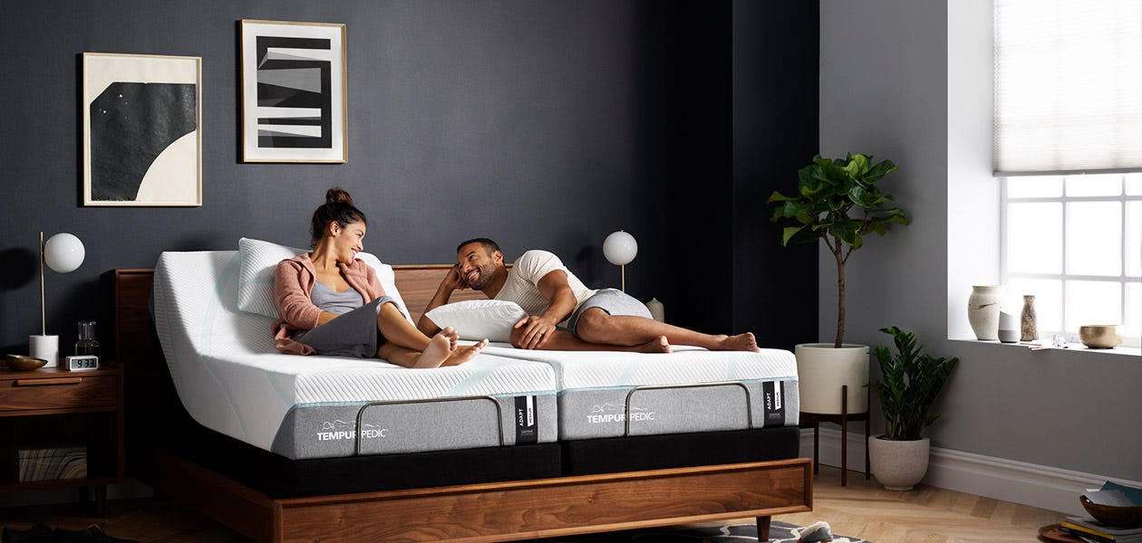 Couple laying on a Tempur-Pedic mattress room photo